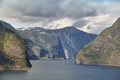 Traditional norwegian fjord landscape with mountains and water. Travel background