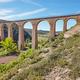 Stone viaduct in Albentosa, Teruel. Spain. Green way. Architecture - PhotoDune Item for Sale