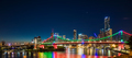 Night time panorama of Brisbane city with purple lights on Story