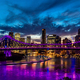 Vibrant night time panorama of Brisbane city with purple lights - PhotoDune Item for Sale