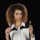 Girl Makes a Choice Between an Electronic Cigarette and an Ordinary One. Black Background