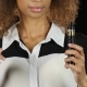 Girl Holds an Ordinary Cigarette in One Hand and an Electronic Cigarette in the Other. Black