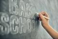 child is writing on blackboard