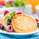 Cottage cheese pancakes, syrniki, curd fritters with berries - PhotoDune Item for Sale
