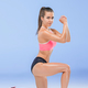 Muscular young woman athlete posing at studio - PhotoDune Item for Sale
