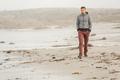 Lone man at USA Pacific coast beach - PhotoDune Item for Sale