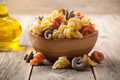 Trottole pasta in a wooden bowl