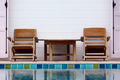 Chair on ground beside swimming pool - PhotoDune Item for Sale
