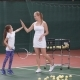 Trainer Woman Giving High Five To Little Girl on Tennis Court