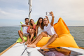 Group of friends having fun in boat in river - PhotoDune Item for Sale