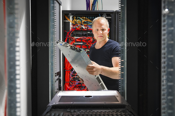 IT Engineer Arranging Server At Datacenter - Stock Photo - Images