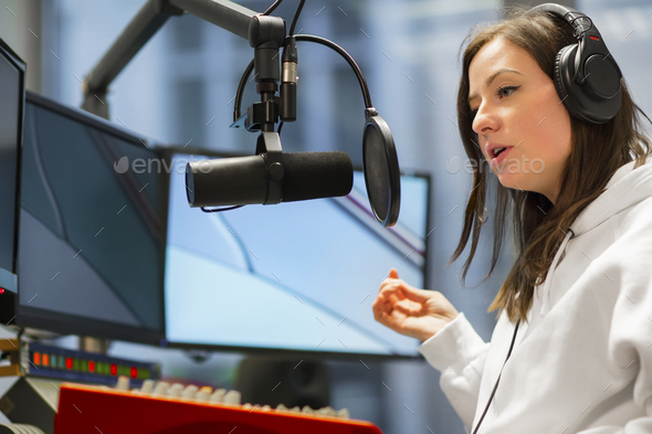 Host Talking On Microphone In Radio Studio - Stock Photo - Images
