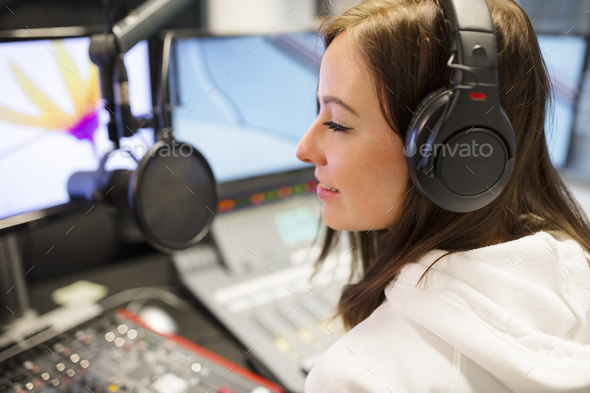 Female Host Wearing Headphones At Radio Studio - Stock Photo - Images