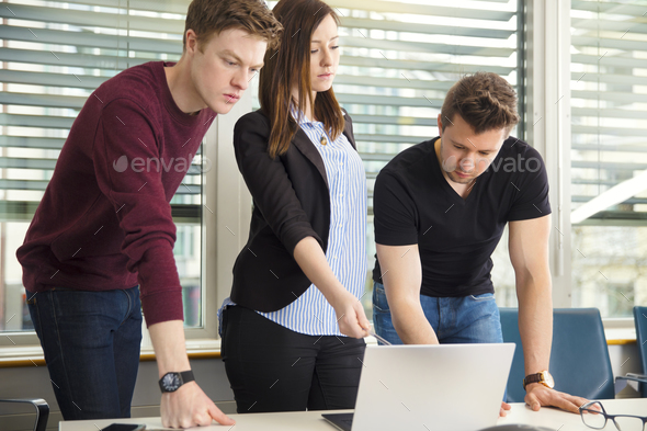 Business People Using Laptop In Office - Stock Photo - Images