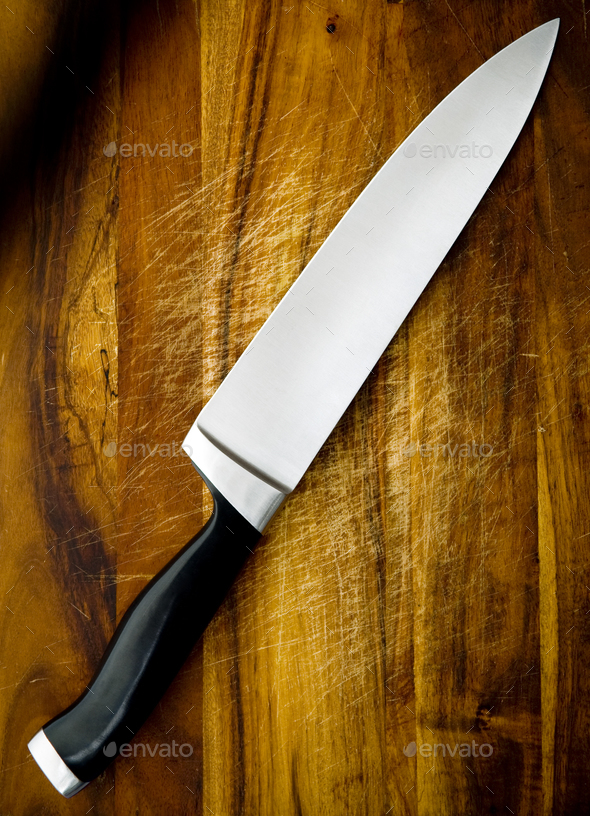 Knife on Chopping Board - Stock Photo - Images