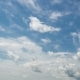Daytime Sky with Fluffy Clouds