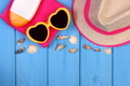 Seashells and accessories for summer or vacation, copy space for text on boards