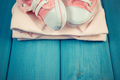 Vintage photo, Shoes and bodysuits for newborn, concept of expecting for baby, copy space for text