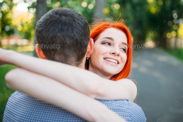 Romantic meeting, young couple hugs together - Stock Photo - Images