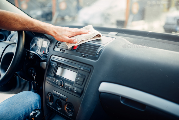 Male hands cleans auto, car dashboard polishing - Stock Photo - Images