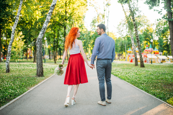 Romantic date, love couple walk in park, back view - Stock Photo - Images