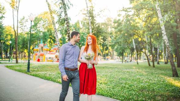 Love couple walk and hugs in summer park - Stock Photo - Images
