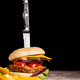 Fast food of tasty delicious burgers on wooden background next t - PhotoDune Item for Sale