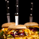 Tasty gourmet delicous burgers on black plate - PhotoDune Item for Sale