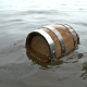 a Barrel of Wood Floating on the Waves in the Sea