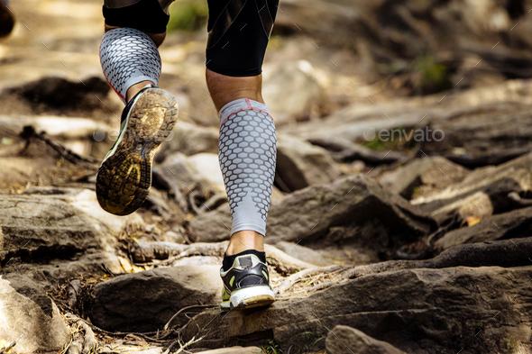 Athlete Runner Running Rocks in Mountain - Stock Photo - Images
