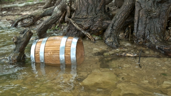 VideoHive a Barrel of Wood Floating on the Waves in the Sea 20379466
