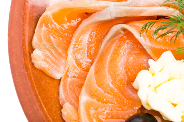 Sliced salmon and butter on plate. - Stock Photo - Images
