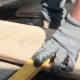 Carpenter Making Measurements and Sawing a Plank - VideoHive Item for Sale