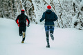 Two Male Athlete Running on Winter Park