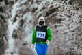 Woman Athlete Running Snow Alley