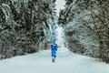 Man Running in Winter Forest