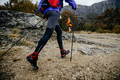 Feet Man Hikers with Walking Poles