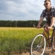 Sporty Guy in Sunglasses Cycling Along Country Trail Outdoor. Young Smiling Man Riding Vintage - VideoHive Item for Sale