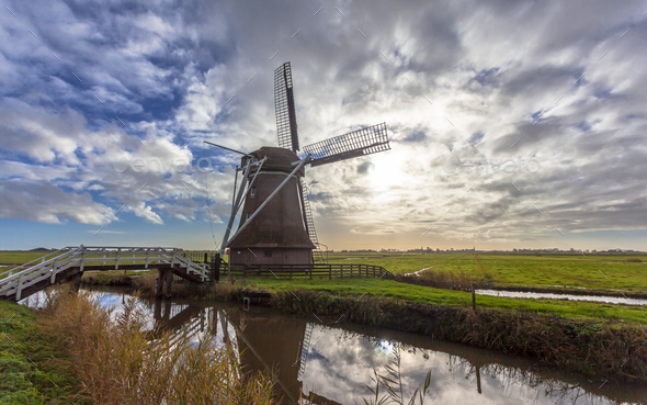 Dutch windmill in frisian polder - Stock Photo - Images