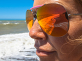 Close up of Sunglasses of a Woman on a beach