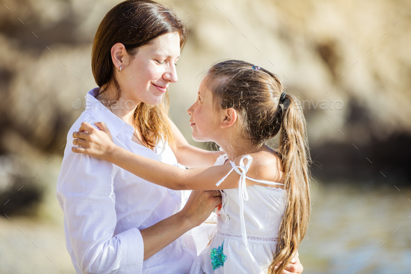 Mother and daughter looking with love at each other and smiling