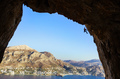 Silhouette of man climbing in cave, Telendos Island, Greece
