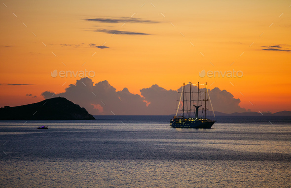View of cruise sailing ship at sunset