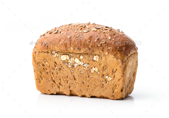 Loaf of wholegrain bread over white