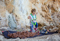 Little girl  playing with rock climbing equipment