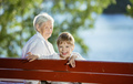 Senior woman and great grandson having fun outdoors