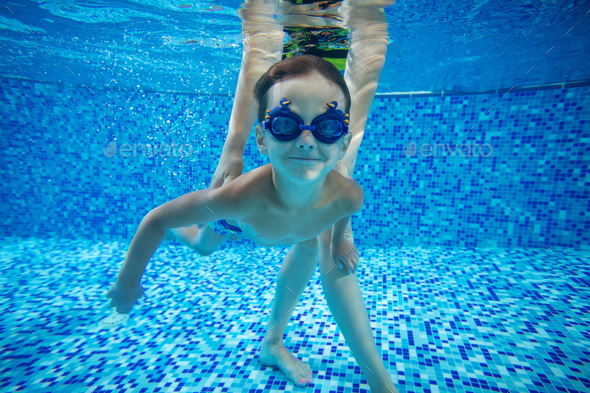 Young boy swimming underwater - Stock Photo - Images
