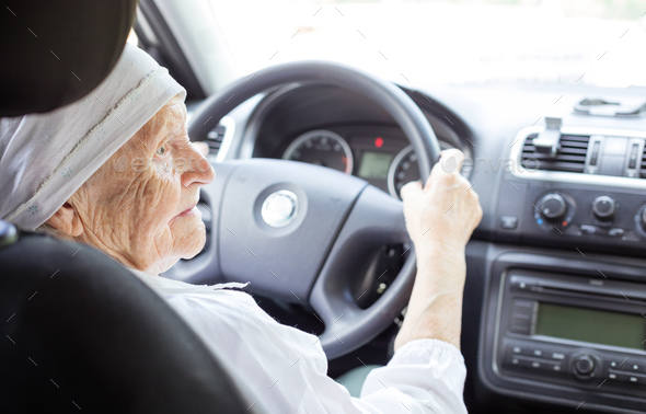 Senior woman driving ca