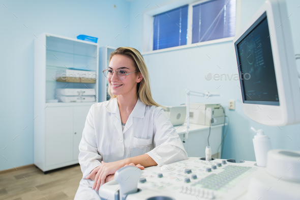 portrait of young female dentist in office - Stock Photo - Images