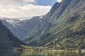 Norwegian fjord landscape with mountains and village. Sorfjorden. Norway. Horizontal
